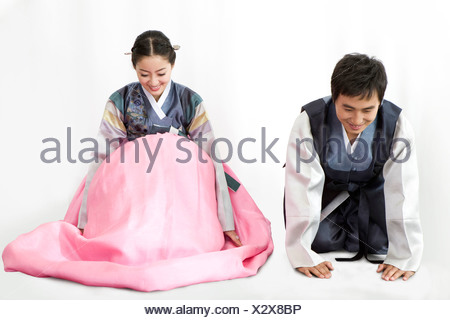 Couple in Korean traditional clothing - Stock Photo