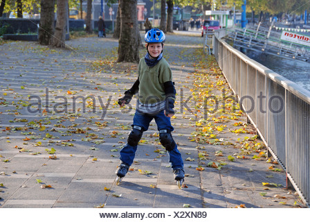 Young inline-skater, Cologne, North Rhine-Westphalia, Germany - Stock Photo