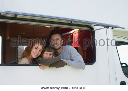 Parents and young boy in motor home, portrait - Stock Photo