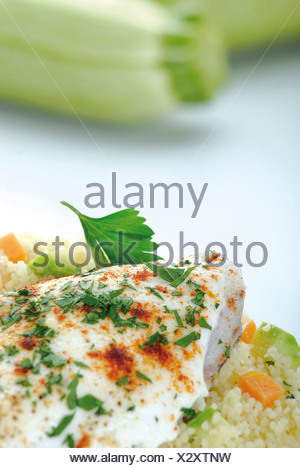 Fish fillets with couscous - Stock Photo