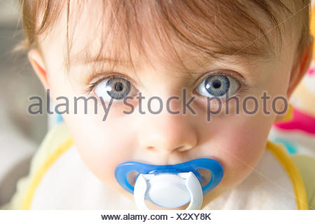 Baby with pacifier - Stock Photo