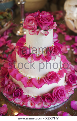 wedding cake decorated with rose petals pink flower covered in frozen water droplets stock 22365