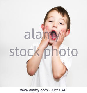 Boy doing home alone pose - Stock Photo