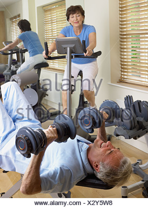 Mature couple working out - Stock Photo