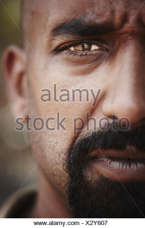 Close up of reflection in mans eye - Stock Photo