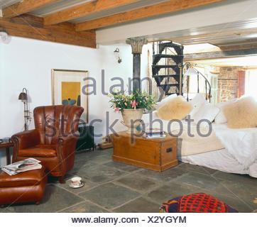 ... Pine Chest In Front Of Cream Sofa With Faux Fur Cushions In Living Room  With Spiral