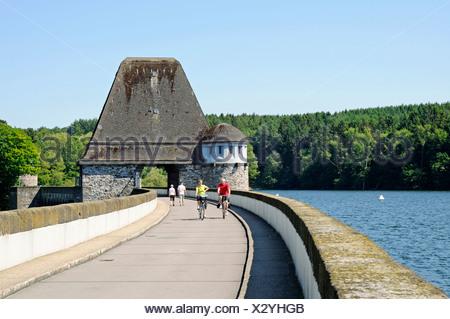 Dam, people, cyclists, recreational sports, Moehnesee lake, Moehne, reservoir, dam, North Rhine-Westphalia, Germany, Europe - Stock Photo