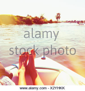 Woman relaxing on a sailing boat, California, United States - Stock Photo
