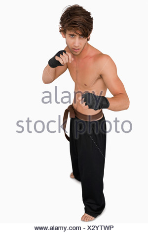 Martial arts fighter in fighting stance - Stock Photo