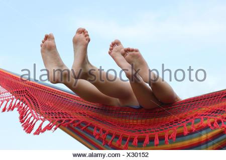 Children's feet in hammock - Stock Photo