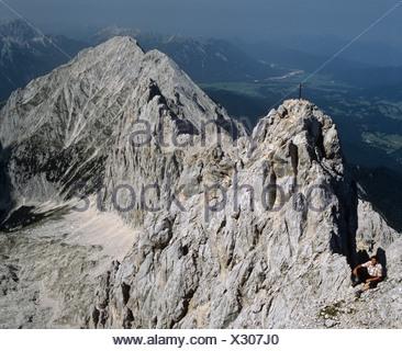 Dreitorspitze central mountaintop, hiker, right hand Musterstein, Wetterstein wall, Wettersteingebirge, Tyrol, Austria - Stock Photo