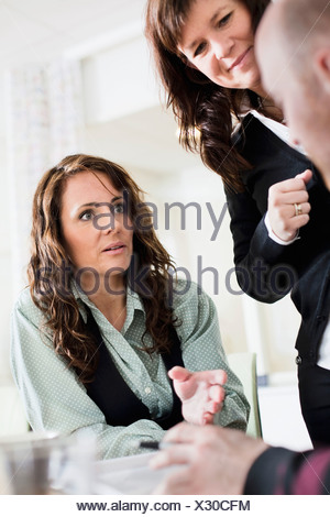 Three colleagues conversating - Stock Photo