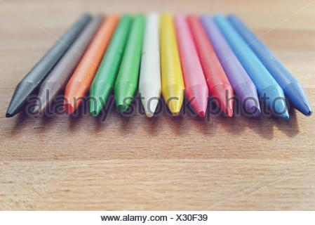Twelve colored pencils lying on table - Stock Photo