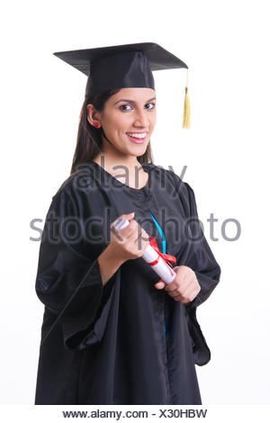 Portrait of happy graduate student holding diploma over white background - Stock Photo