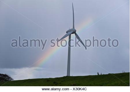 Wind turbine with rainbow, East Frisia, Lower Saxony, Germany, Europe - Stock Photo