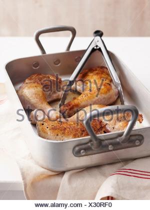 Roast chicken in pan - Stock Photo
