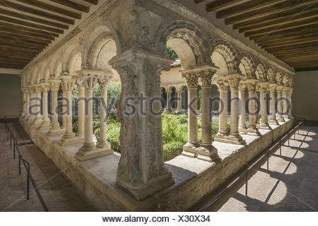 Romanesque cloisters in the Cathedral of the Holy Saviour, Cathedrale Saint Sauveur, in Aix en Provence, Provence-Alpes-Cote d'Azur, France - Stock Photo