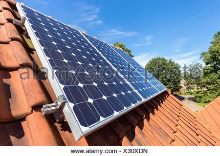 Row of solar panels  on roof - Stock Photo