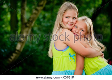 Hugging twins - Stock Photo