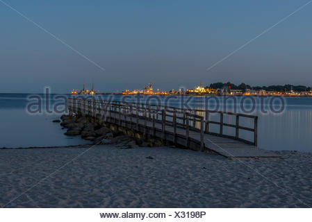 Germany, Eckernfoerde, view to harbour with sea bridge in the foreground - Stock Photo
