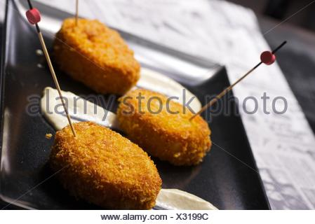Chicken croquettes with cucumber sauce. - Stock Photo