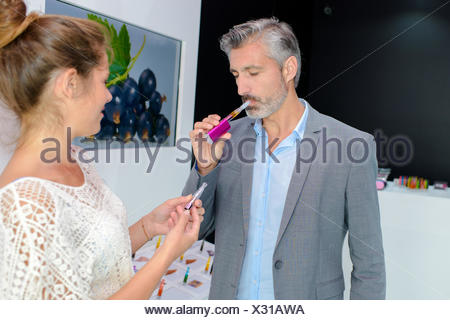 Man trying electronic cigarette - Stock Photo