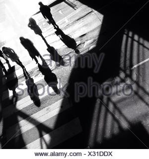 High Angle View Of People Walking On Zebra Crossing - Stock Photo