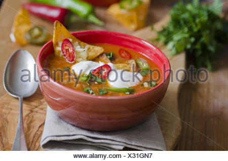 Spicy Mexican Chicken Soup With Tortilla Chips And Chilli Peppers. - Stock Photo