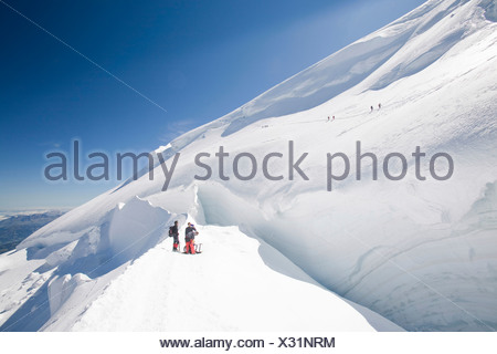 Climbers descending from the summit of the 4000m peak of Mont Blanc du Tacul, Chamonix, France - Stock Photo