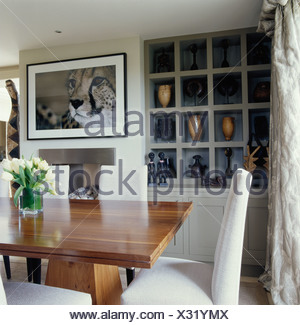 Large picture above fireplace in cream dining room with cube alcove large picture above fireplace in cream dining room with cube alcove shelving and cream chairs at sxxofo