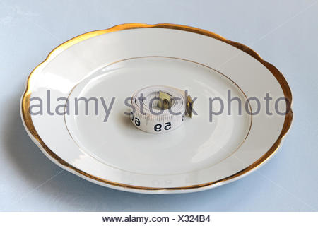 Roll of centimeter on chinaware - Stock Photo