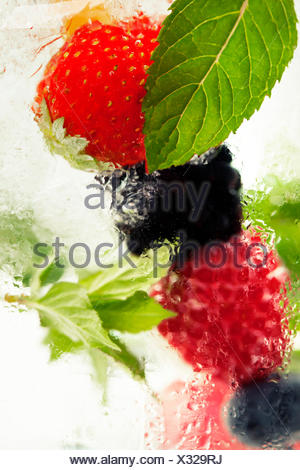 Fruits in the water.  Detox fruit infused flavored water. Refreshing summer homemade cocktail - Stock Photo