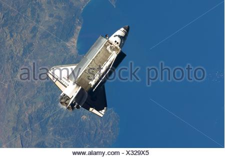 The Way Home Seen over the Mediterranean Sea, near the Algerian coast, the space shuttle Atlantis is featured in this image - Stock Photo