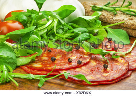 Sausage with lettuce, tomato, garlic and bread - Stock Photo