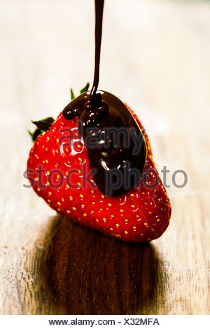 close up of strawberry and chocolate syrup dessert - Stock Photo