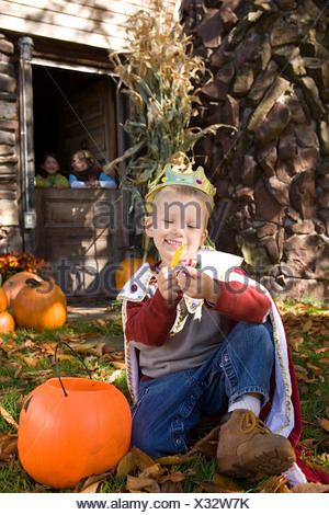 Boy in costume with sweets - Stock Photo