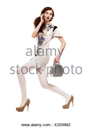 woman profile handbag blue motion postponement moving movement walk go going walking beautiful beauteously nice isolated - Stock Photo