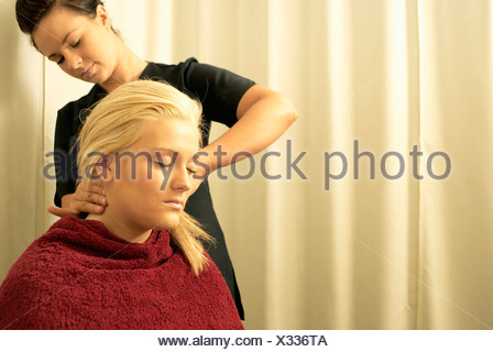 Lady having neck massage - Stock Photo