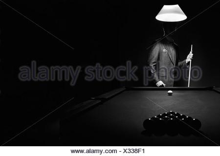 Mystery Pool Player Behind Rack Of Billiard Balls - Stock Photo