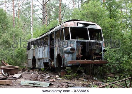 bus wreck - scap motorcar vehicle - junkyard - Stock Photo
