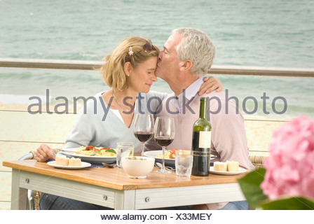Couple dining at seaside restaurant - Stock Photo