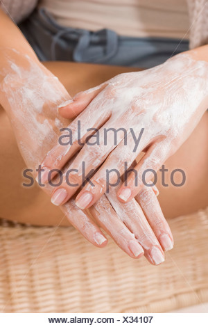 Woman creaming hands - close up - Stock Photo
