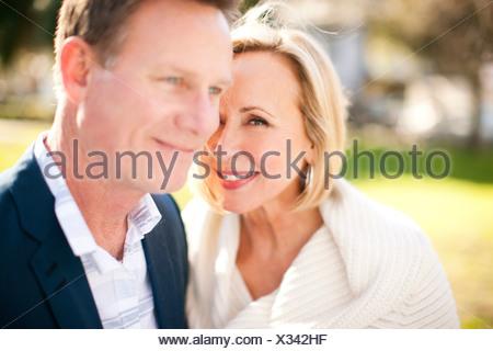 Loving heterosexual couple in park - Stock Photo