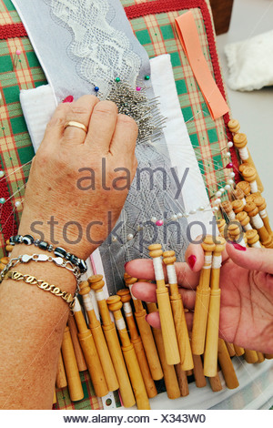 Woman doing traditional lace-making - Stock Photo