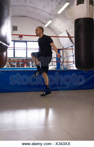 Boxer jumping rope in gym - Stock Photo