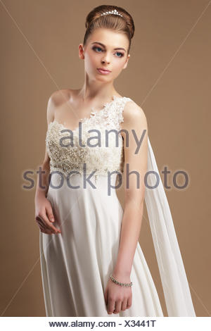Femininity. Gentle Woman in Lacy Dress over Beige Background - Stock Photo