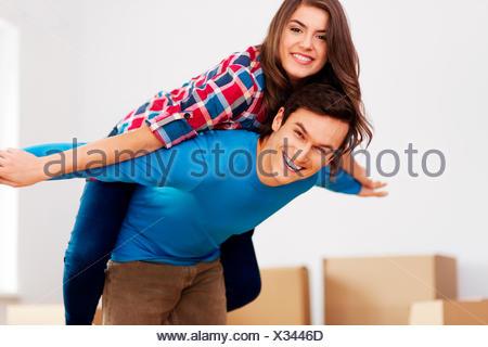 Happy couple in new apartment Debica, Poland - Stock Photo