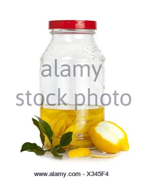 Italian alcoholic beverage - lemon peel in fermentation for limoncello. - Stock Photo