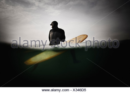 Surfer on Surfboard Anticipating Wave