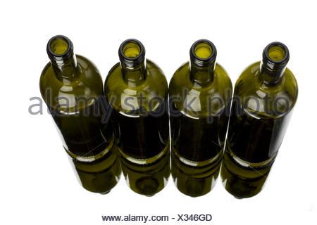 four wine bottles on a mirror - Stock Photo
